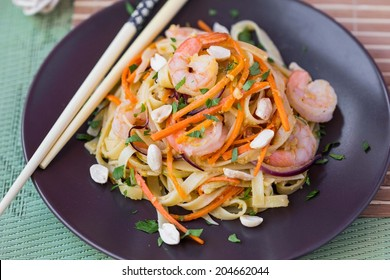 Asian noodles, pasta with shrimp, vegetables, carrots, peanuts, onions, Chinese dish