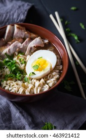 Asian noodles with pork, egg and greens