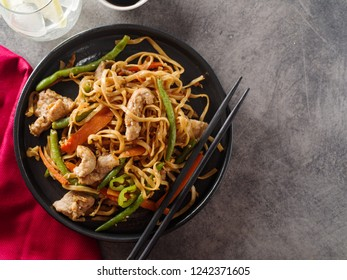 Asian noodles with pork in teriyaki sauce, with green beans, carrots and shiitake mushrooms. Top view.
