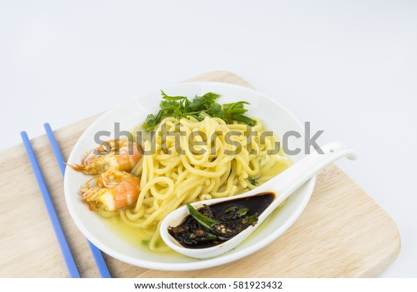 Asian noodles soup with shrimp and soy sauce.