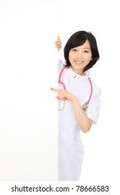 Asian nurse with an empty board