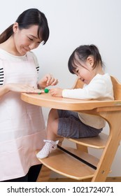 asian nurse playing with a little girl