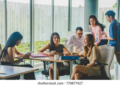 Asian office worker sitting in a relaxed meeting at work.