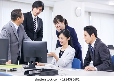 Asian office workers working at the office