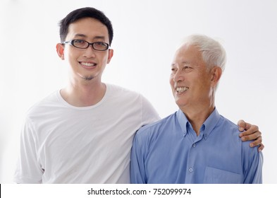 Asian old father and son smiling,  standing isolated on white background.