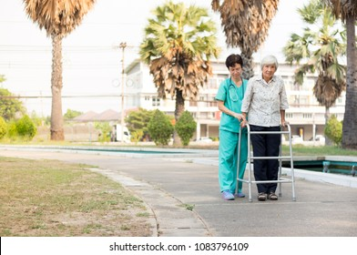 Asian old female train use walker with health worker, stroke patient use walker, walk training, rehabilitation process
