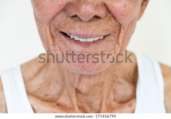 The asian old man's smile on the white background