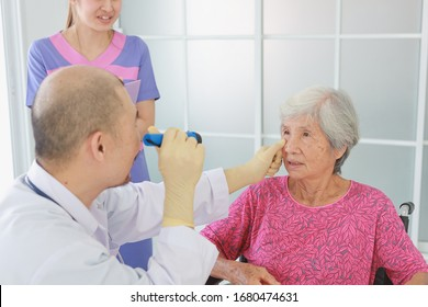 Asian Old Patient woman  Talking with Medical Doctor women in clinic office hospital