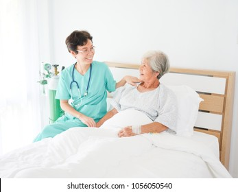 Asian old woman with doctor in the room  hospital in happy mood