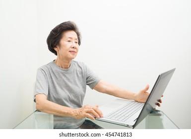 asian old Woman Portrait  use laptop