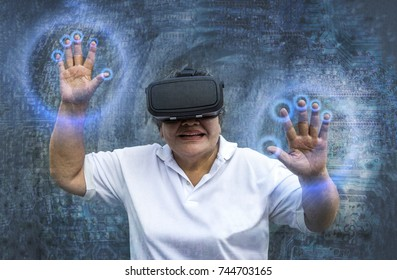 asian old woman wearing virtual reality head set to play simulation on technlogy background