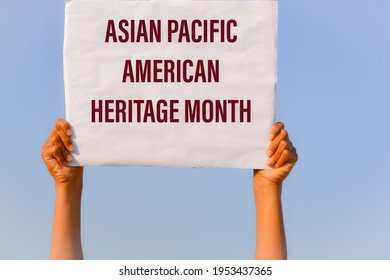 Asian Pacific American Heritage Month with banner in hand in sky background