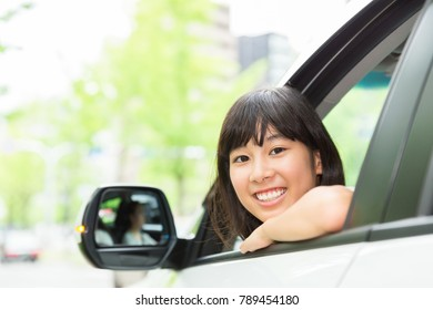 asian parent and daughter in a car