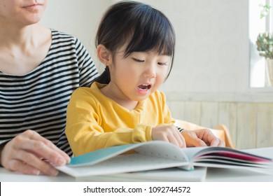 asian parent reading books