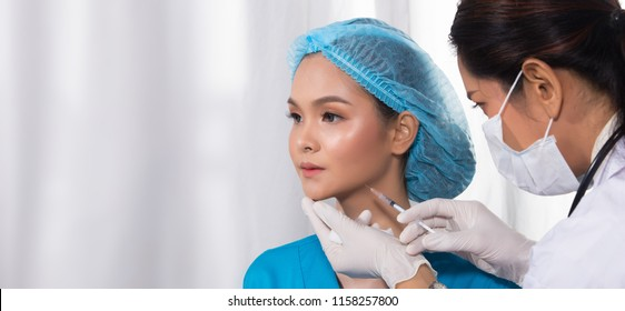 Asian Patient was injected, hyaluronic acid by india middle east Doctor woman uniform with stethoscope in Medical hospital clinic, concept rhinoplastry check before plastic surgery, copy space