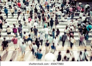 Asian People are across the crosswalk