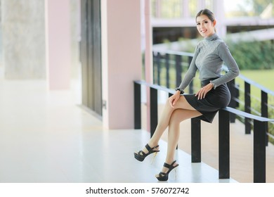 Asian people business woman sit down on the seat balcony, model woman sexy poses and smile