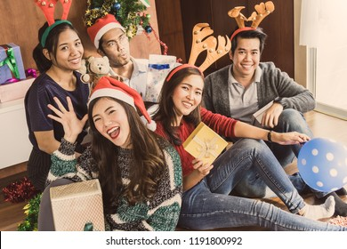 Asian people celebrate Christmas festival party in office for long holiday
