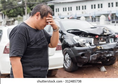 Asian people of desperate man after car crash