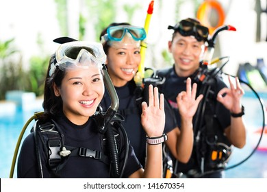 Asian people at the diver Course on holiday in wetsuit with an oxygen tank