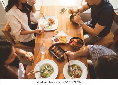 Asian people having breakfast in a restaurant.top view