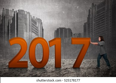 Asian people push 2017 number. Happy new year concept