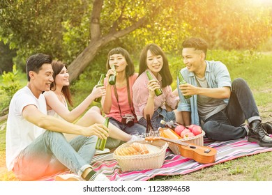 Asian people take a picnic with beer