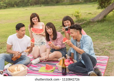 Asian people take a picnic with watermelon