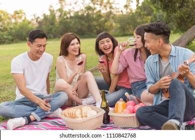 Asian people take a picnic with wine