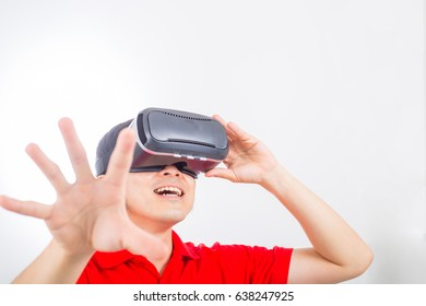 Asian people using VR for watch and play game at home.
