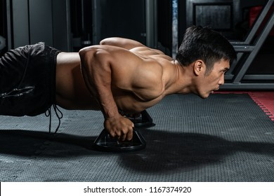 Asian people work out by push-up the floor in  modern gym.