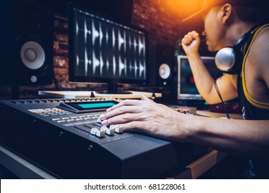 asian popular DJ working in radio broadcasting studio or music producer working in recording studio