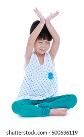 Asian pretty child with eyes closed and  doing yoga exercises in lotus pose. Healthy girl practicing fitness at studio. Sports and active lifestyle. Isolated on white background.