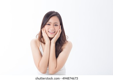 An Asian pretty clean face girl making funny face showing her skin