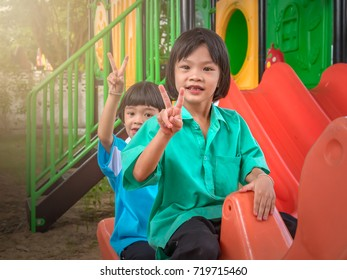 Asian pretty girl child playing in playground in preschool on morning
