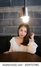 asian pretty girl sitting in cafe with happiness face