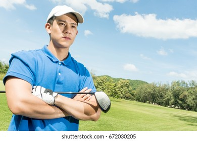 Asian pro golf arm's cross standing, copy space on Right side.