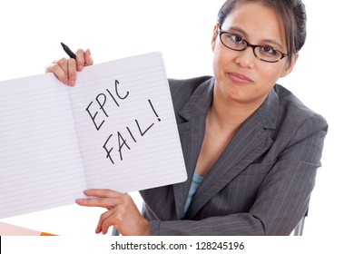 "Asian professor woman holding ""epic fail"" sign in a composition notebook isolated on white background"