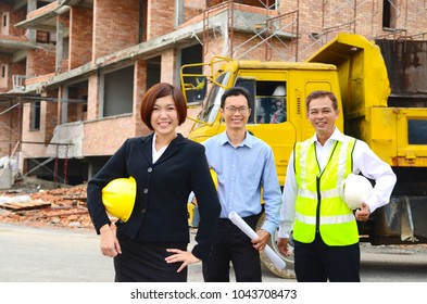 Asian project team at the construction site