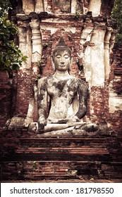 Asian religious art. Ancient sandstone sculpture of Buddha at Wat Mahathat ruins. Ayutthaya, Thailand