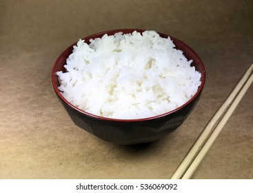 Asian rice bowl on a brown background.