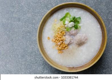 Asian Rice Porridge with Meatballs for Breakfast.