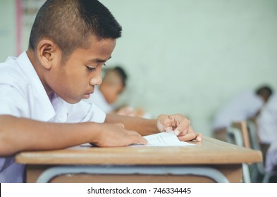 Asian rural student Interest readiness fluency working textbook At desk is writing learning and process teaching in classroom rural thailand assessment Intellect primary school basic education