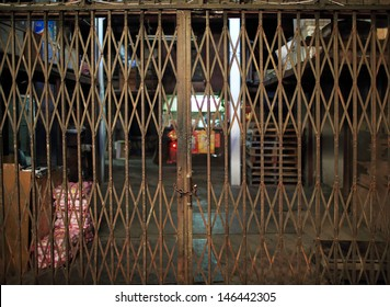 asian rustiness chinese traditional gate or folding doors in the shop with the vintage style - architectural structure in Yau Ma Tei Wholesale Fruit Market in china hong kong