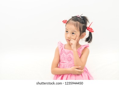 asian sad girl looking up and thinking isolated on white background emotion concept