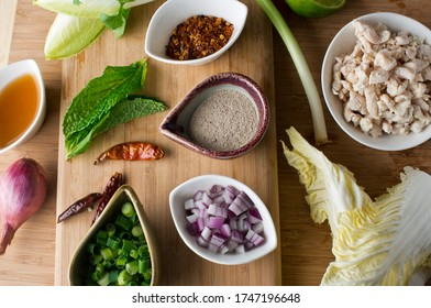 Asian salad Ingredients and garnishes for Thai cuisine. Vietnamese  restaurnt ingredients or garnishes. Garlic cloves, lemongrass, kimchi chili peppers, scallions mushrooms, cilantro, corn, salt .