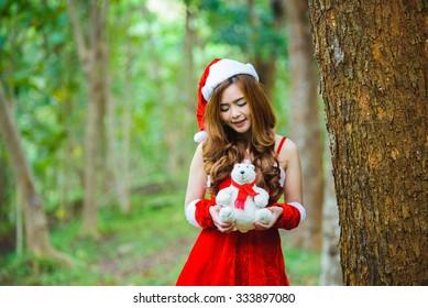 Asian Santa girl with bear