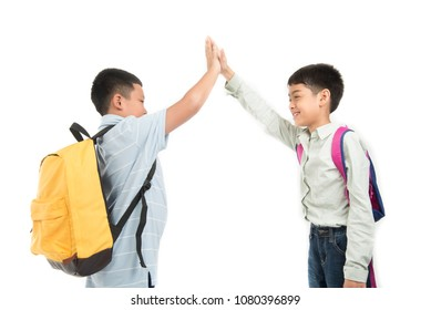 Asian school boy greeting while meet at school hand check new day