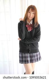Asian school girl smile in white tone