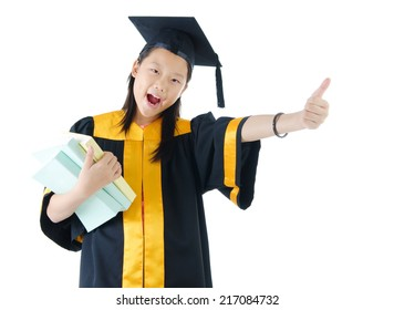 Asian school kid graduate in graduation gown and raised her thumb up.
